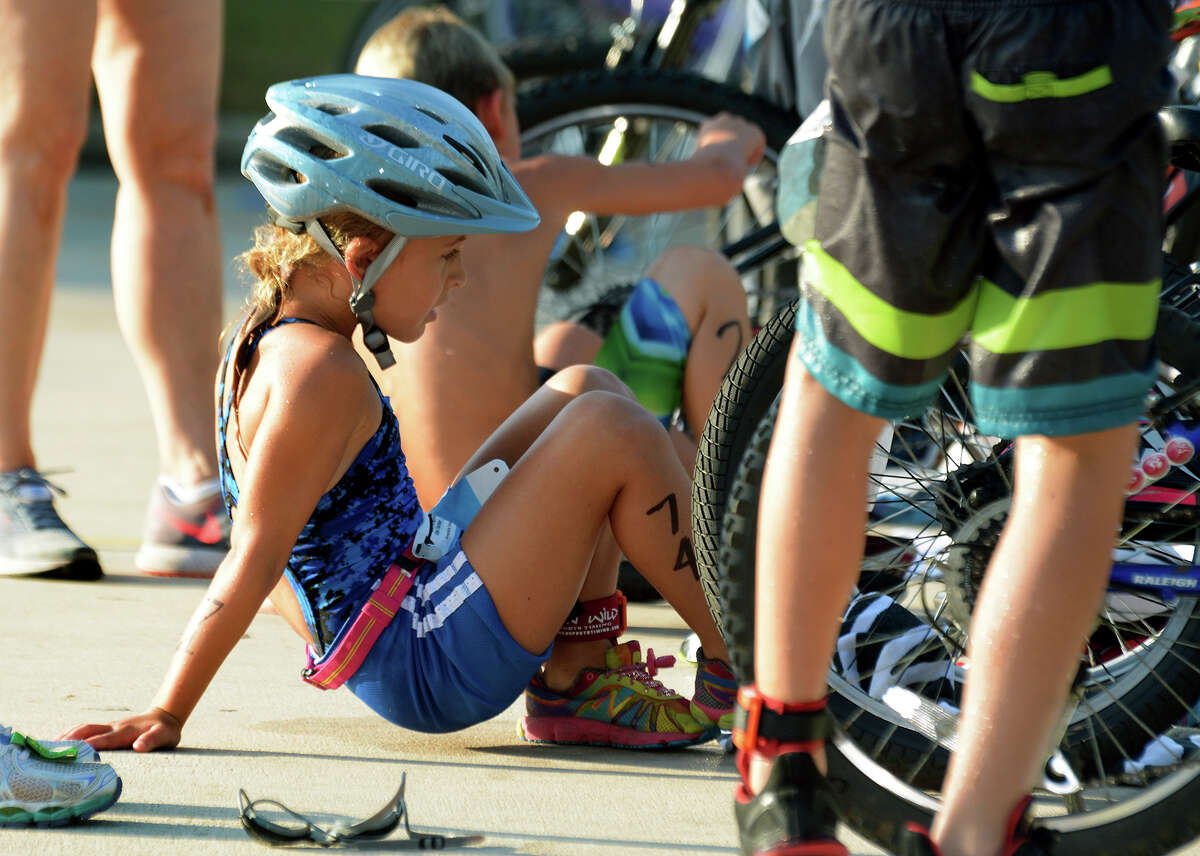 Britton Stratton, 7, a second grader at Zwink Elementary in Klein ISD, makes her transition from swimming to biking during the 2016 The Woodlands Kids Triathlon at The Woodlands Family YMCA at Branch Crossing on Saturday, July 23, 2016.