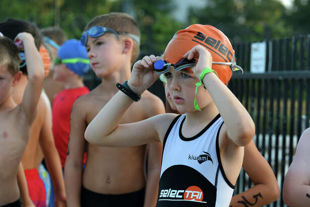 Callen Quinn, 6, right, a kindergartner at The Rubicon Academy in The Woodlands, waits with his fellow competitors for the start of the 2016 The Woodlands Kids Triathlon at The Woodlands Family YMCA at Branch Crossing on Saturday, July 23, 2016. (Photo by Jerry Baker/Freelance)