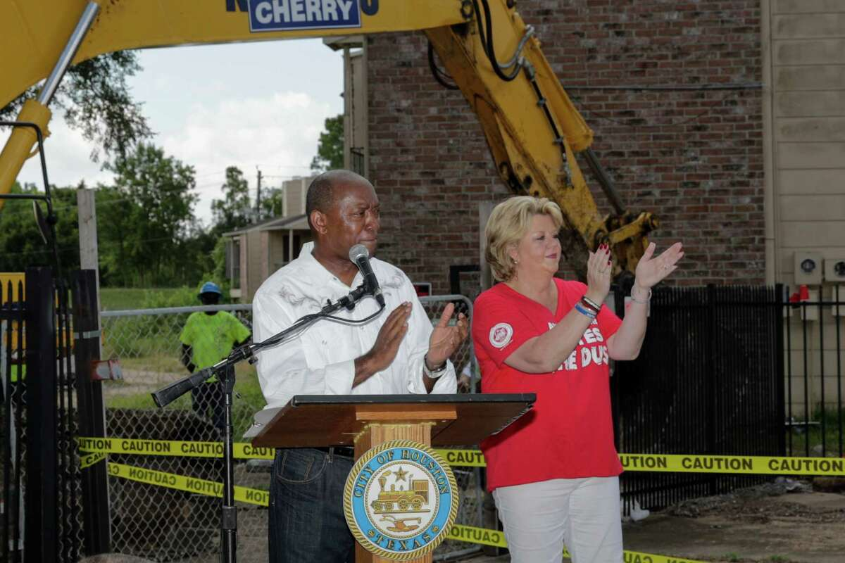 Mayor Sylvester Turner and Houston City Council Member - District A, Brenda Stardig address the crowd at the demolition of the Oakbrook Apartments in Houston, TX on Saturday, July 23, 2016.