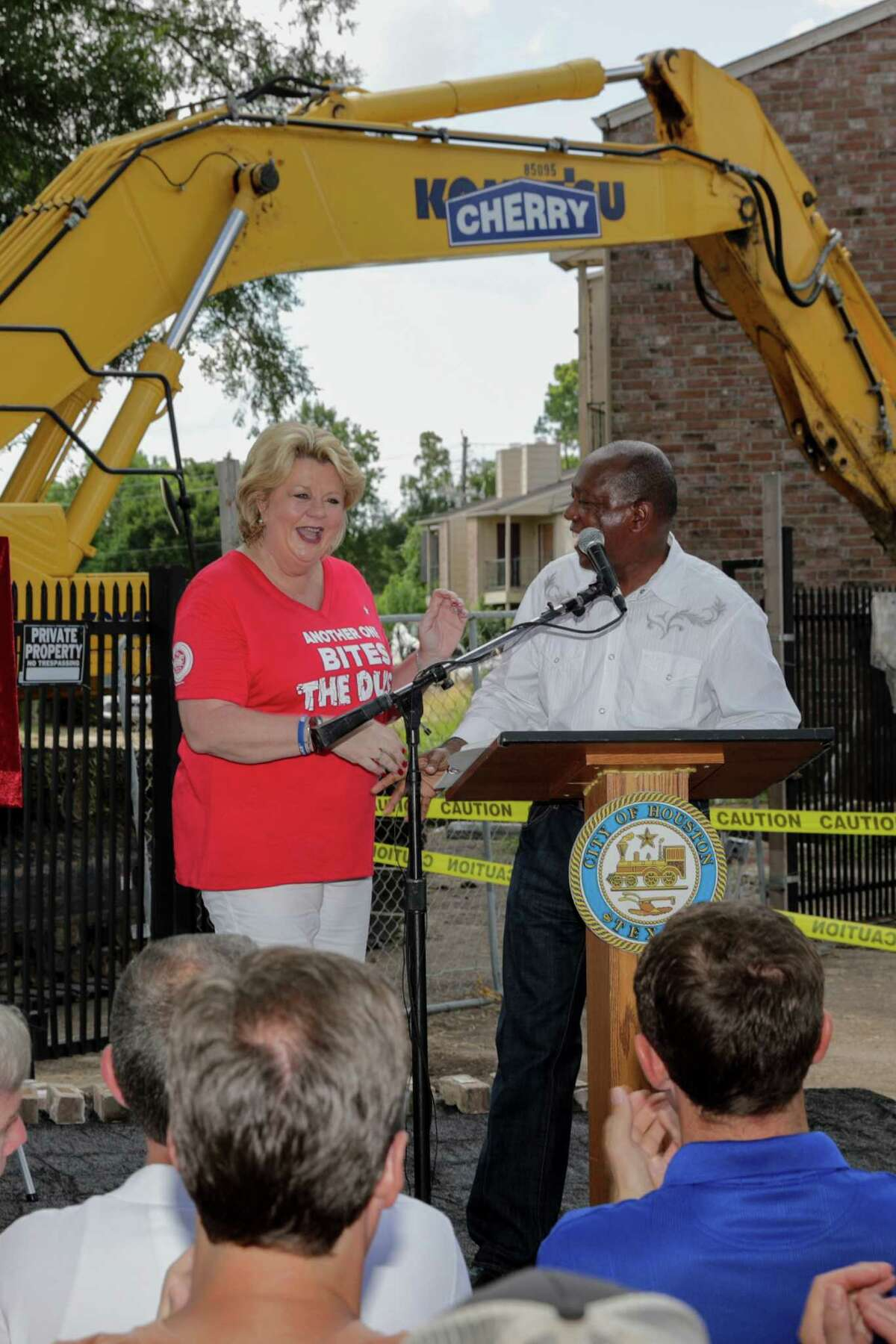 Mayor Sylvester Turner congratulates Houston City Council Member - District A, Brenda Stardig at the demolition of the Oakbrook Apartments in Houston, TX on Saturday, July 23, 2016.