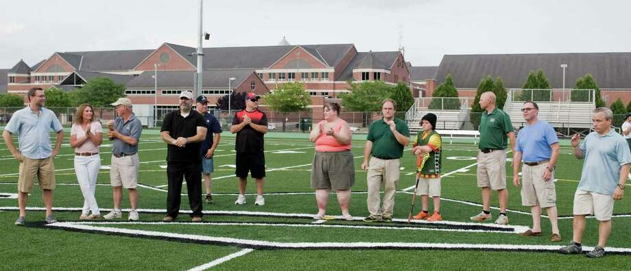 New Milford High School opens it's new athletic field complex. Members of the Turf Committee gathered at the center of the field; Mayor David Gronbach, Wendy Faulenbach, Councilman Frank Wargo, Councilman Pete Bass, Mel McBarity, Doug Skelly, Sue DeBois, Dan Stanton and son Keane, 11, Athletic Director Keith Limpinski, Joe Failia and Lou Alhage. Friday, July 22, 2016 Photo: Scott Mullin / For Hearst Connecticut Media / The News-Times Freelance