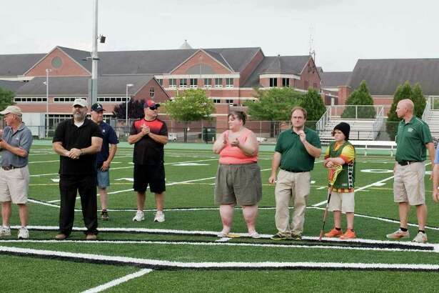New Milford High School opens it's new athletic field complex. Members of the Turf Committee gathered at the center of the field; Mayor David Gronbach, Wendy Faulenbach, Councilman Frank Wargo, Councilman Pete Bass, Mel McBarity, Doug Skelly, Sue DeBois, Dan Stanton and son Keane, 11, Athletic Director Keith Limpinski, Joe Failia and Lou Alhage. Friday, July 22, 2016