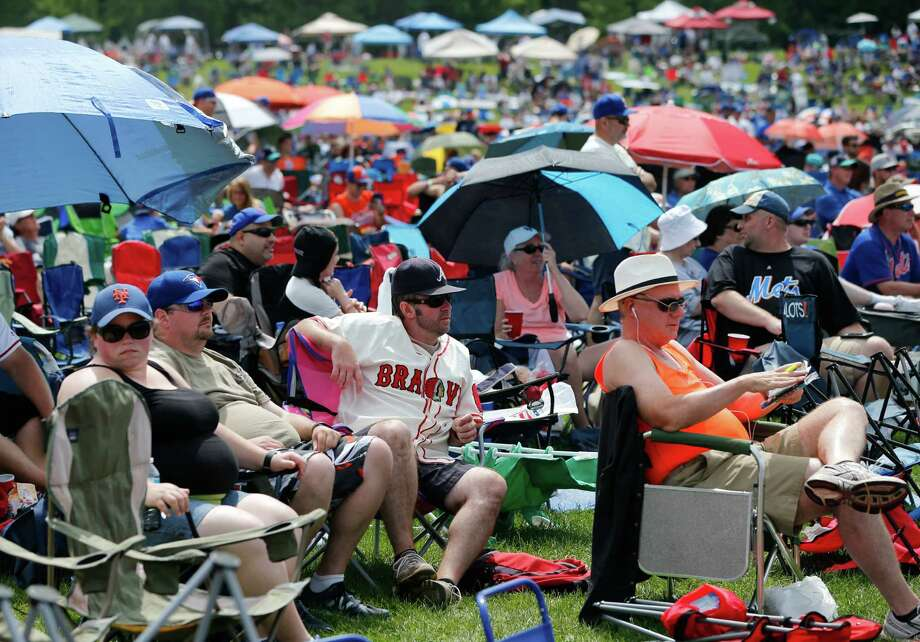 Fans wait for the start of the National Baseball Hall of Fame induction ceremony at the Clark Sports Center on Sunday, July 24, 2016, in Cooperstown, N.Y. Former players Mike Piazza and Ken Griffey Jr. will be inducted. (AP Photo/Mike Groll) ORG XMIT: NYMG104 Photo: Mike Groll / Copyright 2016 The Associated Press. All rights reserved. This m