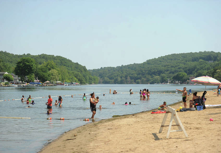 Visitors cool off in the Housatonic River at Indian Well State Park in Shelton, Conn. on Wednesday, July 6, 2016. Photo: Brian A. Pounds / Hearst Connecticut Media / Connecticut Post
