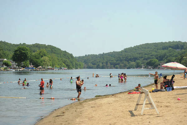 Visitors cool off in the Housatonic River at Indian Well State Park in Shelton, Conn. on Wednesday, July 6, 2016.