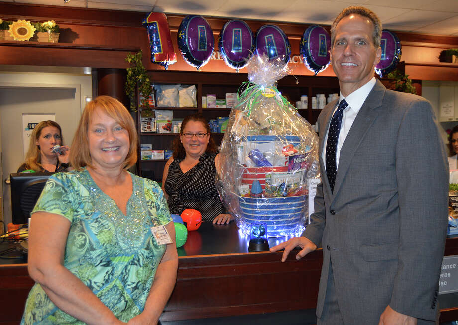 Michele Mahan-Bibber, of Derby, is congratulated by Griffin Hospital President and CEO Patrick Charmel on being the one millionth customer of Griffin Pharmacy & Gifts in Derby. Photo courtesy of Griffin Hospital Photo: Contributed
