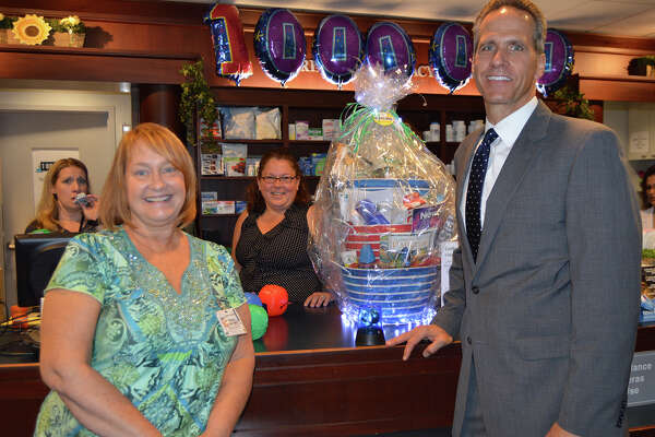 Michele Mahan-Bibber, of Derby, is congratulated by Griffin Hospital President and CEO Patrick Charmel on being the one millionth customer of Griffin Pharmacy & Gifts in Derby. Photo courtesy of Griffin Hospital