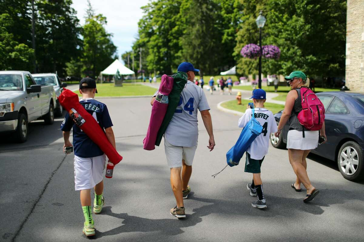 Fans of inductee Ken Griffey Jr. walk through town during the 2016 Hall of Fame Induction Ceremony at the National Baseball Hall of Fame on Sunday July 24, 2016 in Cooperstown, New York.