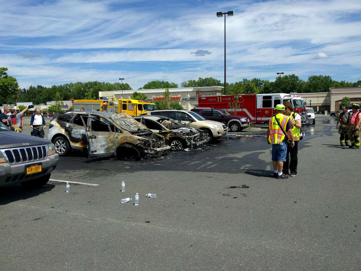 Two cars were destroyed Sunday, July 24, 2016 after one of them burst into flames in the parking lot of Market Bistro by Price Chopper in Latham. (j.p. Lawrence)