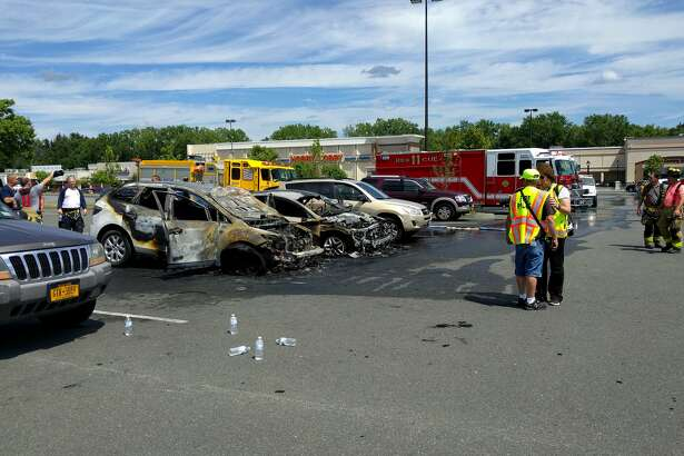 Two cars were completely destroyed Sunday, July 24, 2016 after one of them burst into flames in the parking lot of Market Bistro by Price Chopper in Latham. (j.p. Lawrence)