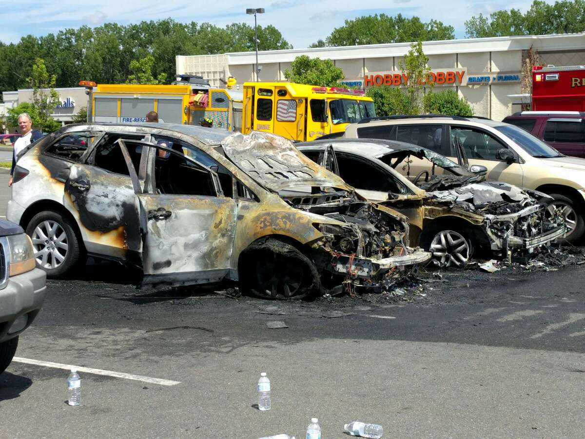 Two cars were destroyed Sunday, July 24, 2016 after one of them burst into flames in the parking lot of Market Bistro by Price Chopper in Latham. There were no reported injuries. (j.p. Lawrence)