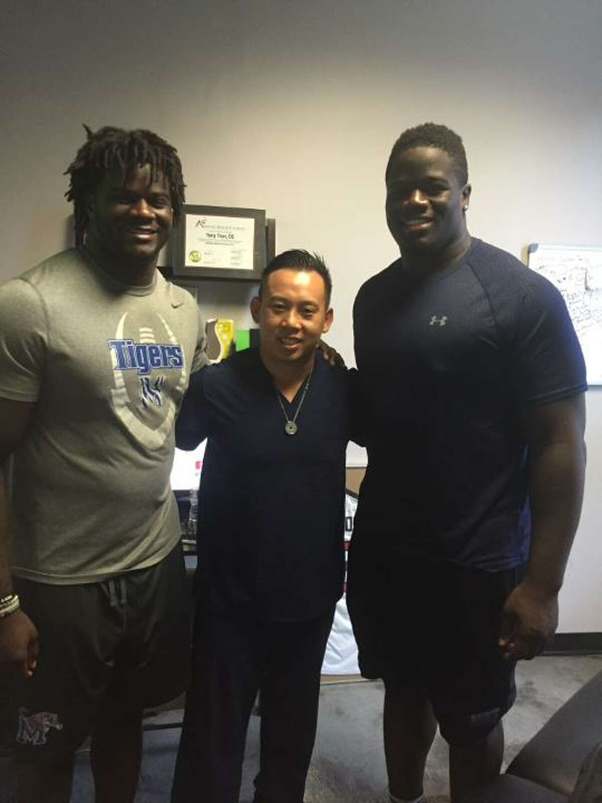 Seattle Seahawks first-round draft pick Germain Ifedi (right), a former Texas A&M and Westside standout, with his brother, Martin Ifedi, and Dr. Tony Tran at IX Innovations.