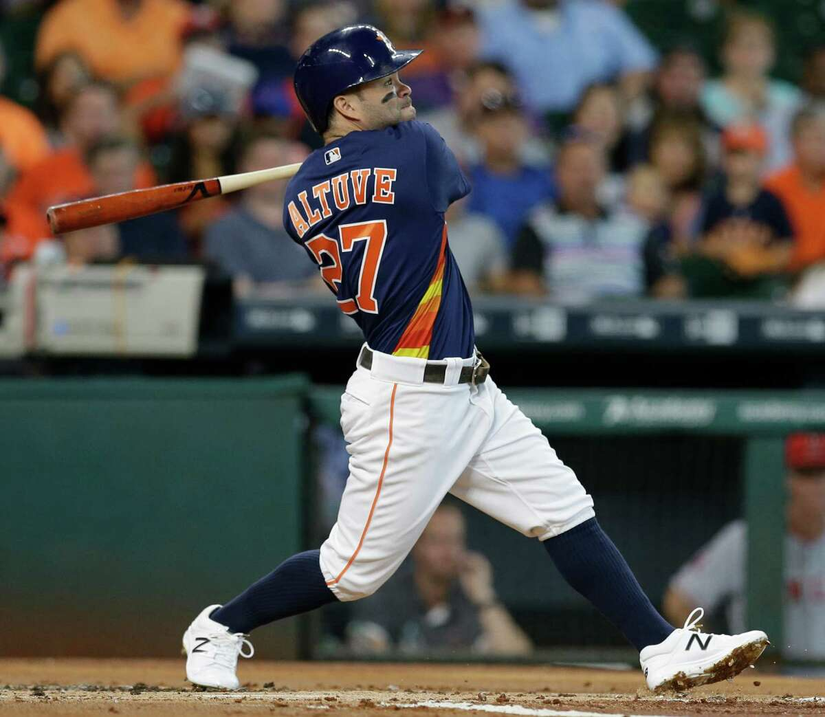 Houston Astros Jose Altuve hits a three home run against the Los Angeles Angels during the first inning at Minute Maid Park Sunday, July 24, 2016, in Houston. George Springer and Marwin Gonzalez scored on the home run.