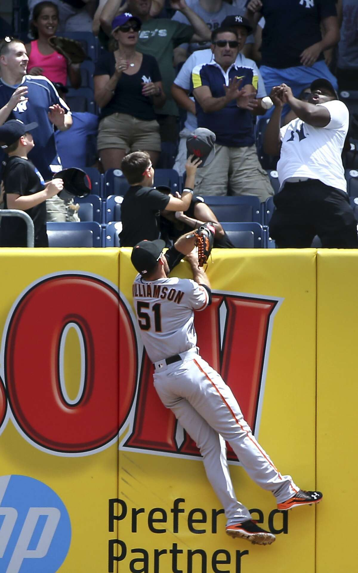 San Francisco Giants right fielder Mac Williamson cannot catch a home run hit by New York Yankees' Carlos Beltran during the first inning of the baseball game at Yankee Stadium, Sunday, July 24, 2016, in New York. (AP Photo/Seth Wenig)