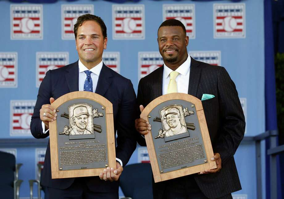 National Baseball Hall of Fame inductees Mike Piazza, left, and Ken Griffey Jr. hold their plaques after an induction ceremony at the Clark Sports Center on Sunday, July 24, 2016, in Cooperstown, N.Y. (AP Photo/Mike Groll) ORG XMIT: NYMG108 Photo: Mike Groll / Copyright 2016 The Associated Press. All rights reserved. This m