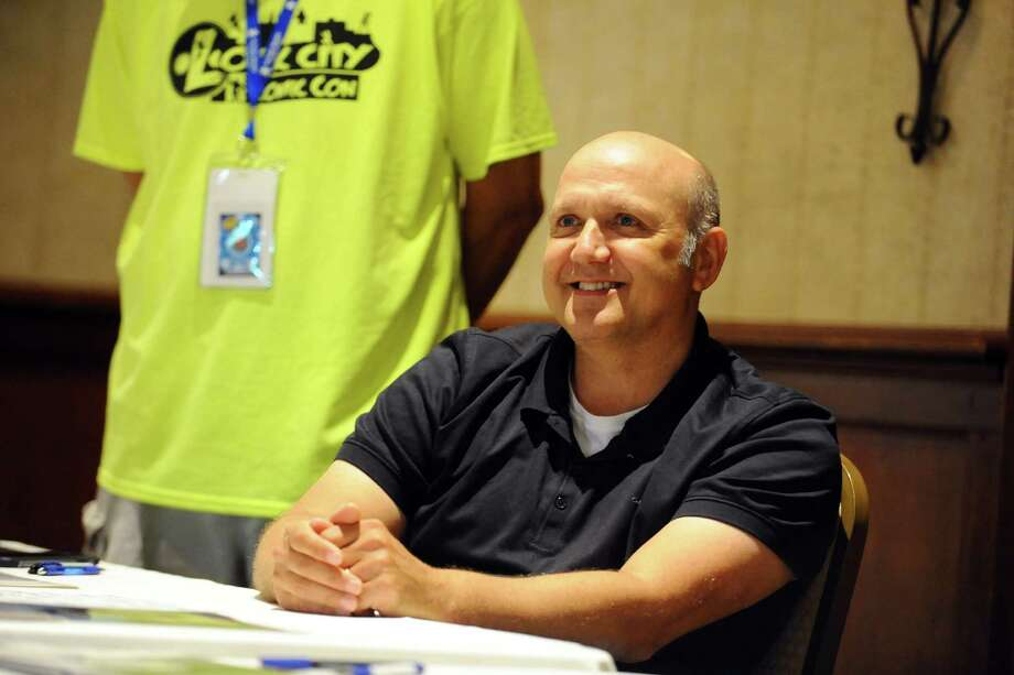 Paris Themmen, the actor who plays Mike Teavee in the 1971 version of 'Willy Wonka and the Chocolate Factory' smiles while talking with a fan during the first ever Lock City Comic Con held at the Italian Center of Stamford, on Newfield Avenue, on Sunday, July 24, 2016. Photo: Michael Cummo, Hearst Connecticut Media / Stamford Advocate