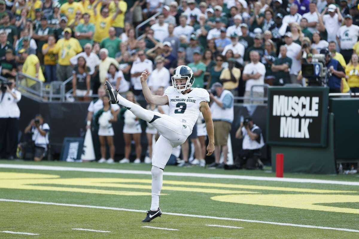 EUGENE, OR - SEPTEMBER 6: Mike Sadler #3 of the Michigan State Spartans punts the ball against the Oregon Ducks during the game at Autzen Stadium on September 6, 2014 in Eugene, Oregon. Oregon won 46-27. (Photo by Joe Robbins/Getty Images)