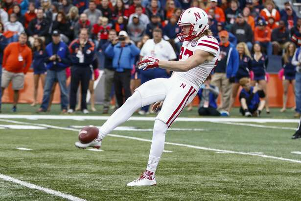 CHAMPAIGN, IL - OCTOBER 3: Sam Foltz #27 of the Nebraska Cornhuskers punts the ball against the Illinois Fighting Illini at Memorial Stadium on October 3, 2015 in Champaign, Illinois.  Illinois defeated Nebraska 14-13. (Photo by Michael Hickey/Getty Images)