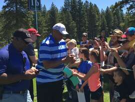 Charles Barkley takes times for the fans at the American Century Championship, July 24, 2016. .