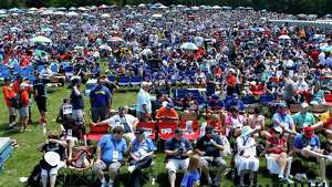 Fan wait for the National Baseball Hall of Fame induction ceremony at the Clark Sports Center on Sunday, July 24, 2016, in Cooperstown, N.Y. (AP Photo/Mike Groll) ORG XMIT: NYMG121