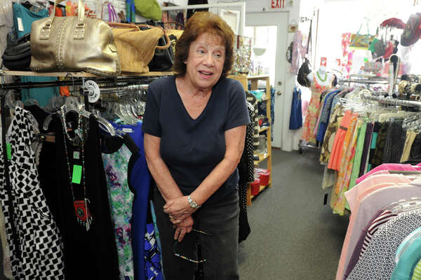 Patrica Haynes, owner of Hope Chest Consignments speaks about the recently completed redevelopement project around her business on Hope St., in the Springdale section of Stamford, Conn. July 7, 2016. Haynes says the project has had a negative impact on her business.