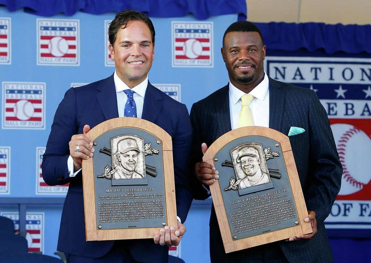 COOPERSTOWN, NY - JULY 24: Mike Piazza (L) and Ken Griffey Jr. pose with thier plaques at Clark Sports Center after the Baseball Hall of Fame induction ceremony on July 24, 2016 in Cooperstown, New York.