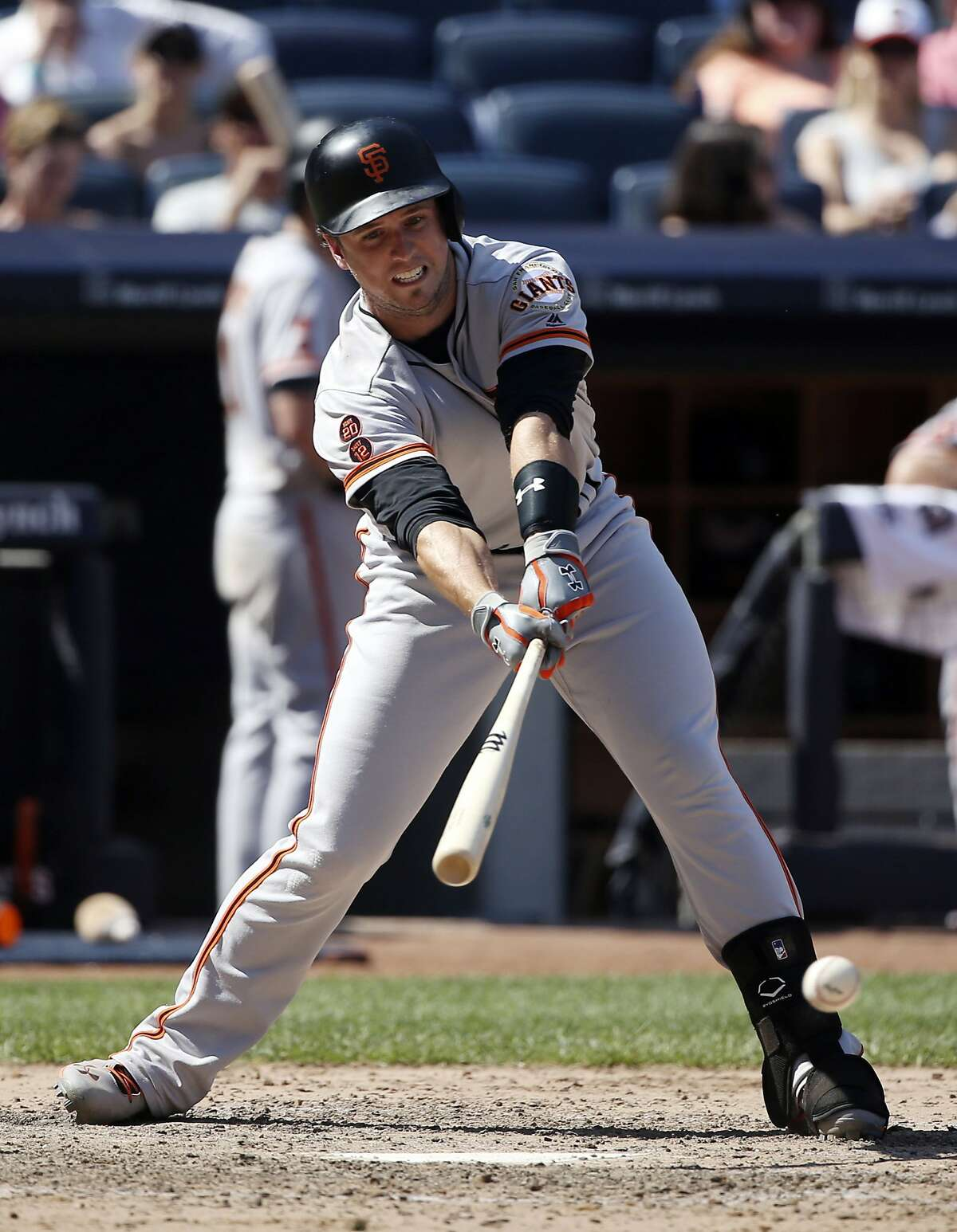 San Francisco Giants' Buster Posey hits a two-run single during the seventh inning of a baseball game against the New York Yankees at Yankee Stadium, Sunday, July 24, 2016, in New York. (AP Photo/Seth Wenig)