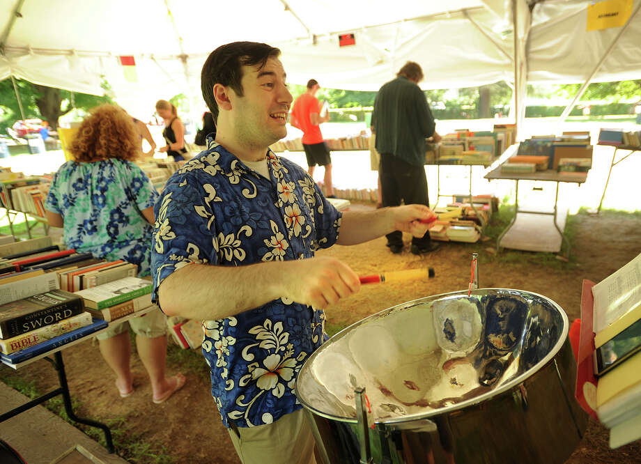 Brian Ente, of Derby, entertains used book shoppers performing tunes on the steel drum at the 56th Annual Pequot Library Summer Book Sale in the Southport section of Fairfield, Conn. on Sunday, July 24, 2016. The sale continues with items half price on Monday from 9 am- 6 pm and 5 dollars/bag on Tuesday from 9 am- 2 pm. Photo: Brian A. Pounds, Hearst Connecticut Media / Connecticut Post