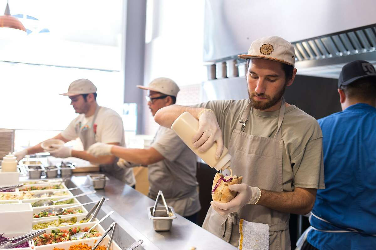 Dylan Cantu makes a pita sandwhich at Sababa in S.F.