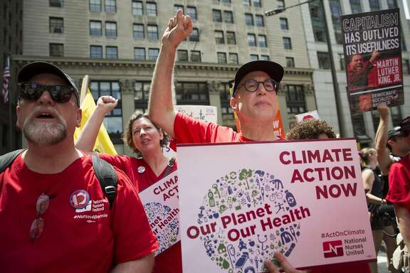 07/24/16 Philadelphia, PA  Policy director of National Nurses United Michael Lighty marches with members of National Nurses United through the streets of Center City Philadelphia for action on climate change.
