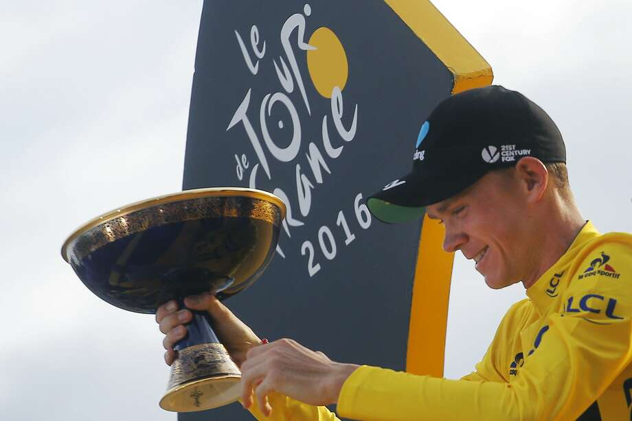 Overall winner Chris Froome of Britain celebrates on the podium after the 21st and final stage of the Tour de France cycling race in Paris. It's his third Tour victory in the past four years. Photo: Christophe Ena, Associated Press