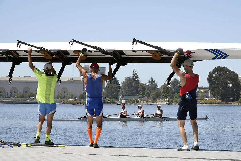 Crews get their boats into the water before their race during the U.S. Rowing 2016 Southwest Masters Regional Championships held on Lake Merritt in Oakland. Photo: Michael Short, Special To The Chronicle