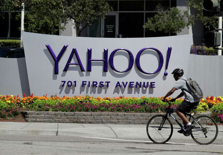 A cyclist rides in front of the Yahoo sign at the company's headquarters Tuesday, July 19, 2016, in Sunnyvale, Calif. (AP Photo/Marcio Jose Sanchez) Photo: Marcio Jose Sanchez, STF / AP