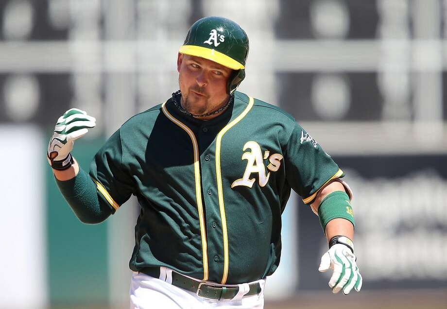 Billy Butler #16 of the Oakland Athletics celebrates a solo homerun in the bottom of the eighth inning to regain the lead against the Tampa Bay Rays at the Oakland-Alameda Coliseum on July 24, 2016 in Oakland, California. Photo: Don Feria, Getty Images