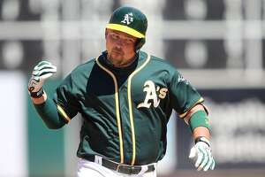 OAKLAND, CA - JULY 24: Billy Butler #16 of the Oakland Athletics celebrates a solo homerun in the bottom of the eighth inning to regain the lead against the Tampa Bay Rays at the Oakland-Alameda Coliseum on July 24, 2016 in Oakland, California.  (Photo by Don Feria/Getty Images)