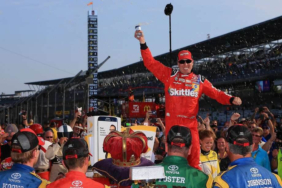 Kyle Busch celebrates after the NASCAR Sprint Cup Series Brickyard 400 in Indianapolis. Photo: Daniel Shirey, Getty Images