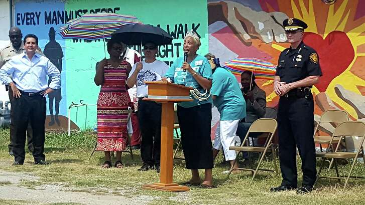 Bishop Rosita Wilson talks during an anti-violence rally at the Greater Faith Institutional Church Sunday afternoon as S.A. Police Chief William McManus looks on.