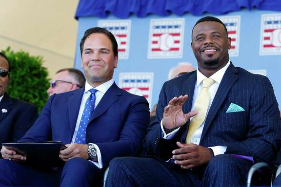 Mike Piazza, left, and Ken Griffey Jr. soak up the atmosphere on their big day in Cooperstown.