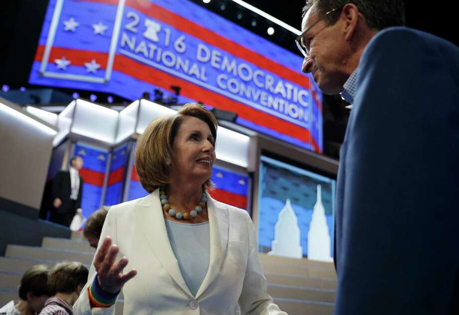 House Minority Leader Nancy Pelosi of Calif., left, speaks with Gov. Dannel P. Malloy before the 2016 Democratic Convention, Sunday in Philadelphia. Photo: John Locher / Associated Press / Copyright 2016 The Associated Press. All rights reserved. This material may not be published, broadcast, rewritten or redistribu