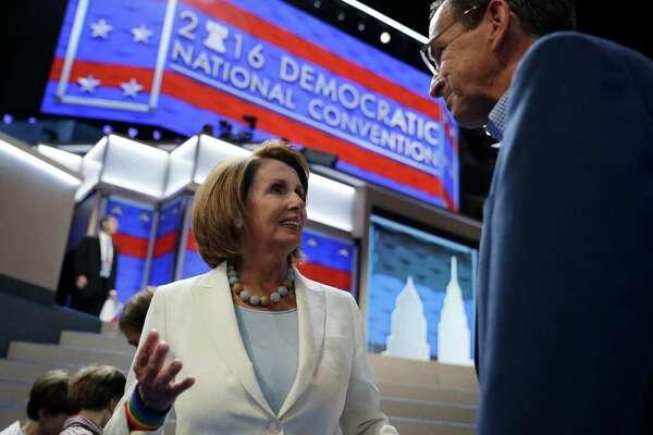 House Minority Leader Nancy Pelosi of Calif., left, speaks with Gov. Dannel P. Malloy before the 2016 Democratic Convention, Sunday in Philadelphia.