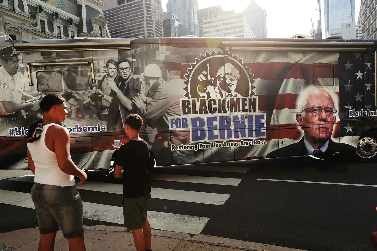 PHILADELPHIA, PA - JULY 24: A bus supporting Bernie Sanders supporters drives through downtown before the start of the Democratic National Convention (DNC) on July 24, 2016 in Philadelphia, Pennsylvania. The convention officially begins on Monday and is expected to attract thousands of protesters, members of the media and Democratic delegates to the City of Brotherly Love. (Photo by Spencer Platt/Getty Images)