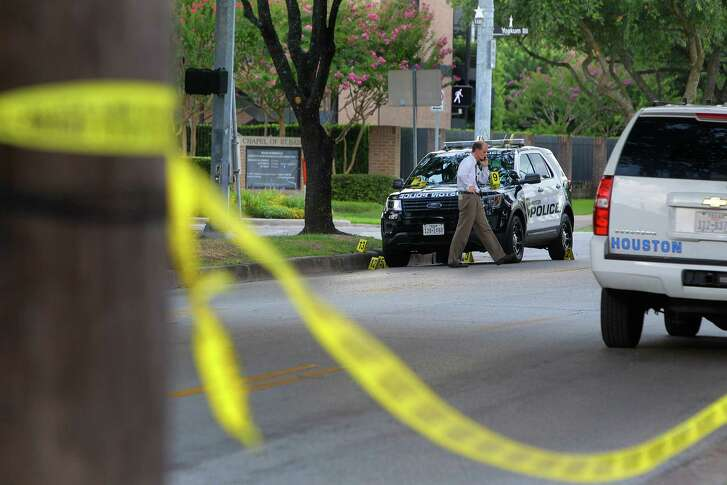 Police investigate the site of an officer involved shooting at Yoakum Boulevard and W. Alabama Street near the University of St. Thomas, Sunday, July 24, 2016, in Houston. Officers responded to reports of a man with a gun Sunday afternoon.