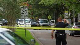 Yoakum Boulevard is blocked off within the University of St. Thomas near the site of an officer involved shooting, Sunday, July 24, 2016, in Houston. Officers responded to reports of a man with a gun Sunday afternoon.
