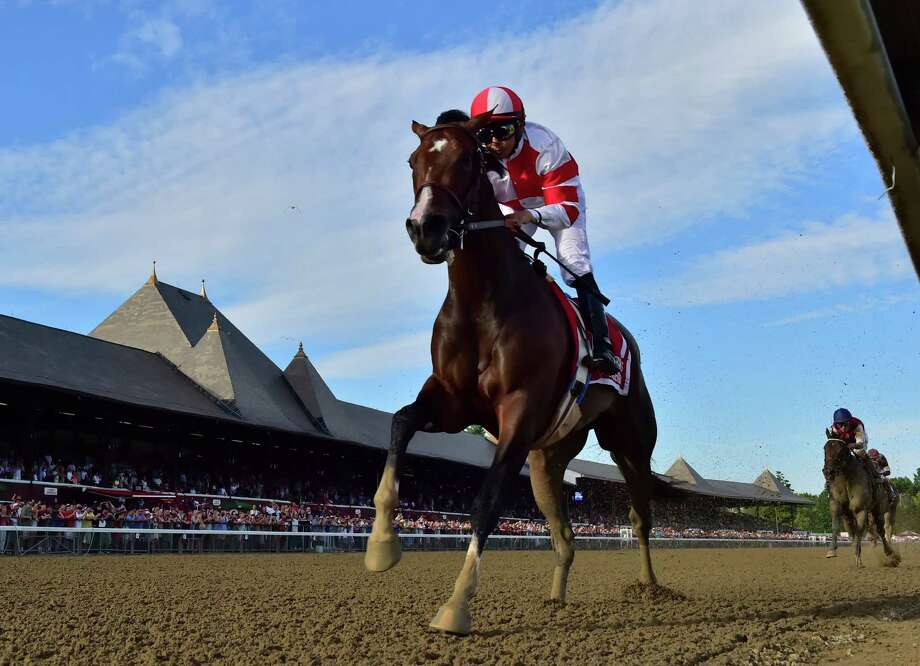 Songbird with jockey Mike Smith outruns the field to win the 100th running of The Coaching Club American Oaks Sunday July 24 2016 at the Saratoga Race Course in Saratoga Springs, N.Y. (Skip Dickstein/Times Union) Photo: SKIP DICKSTEIN