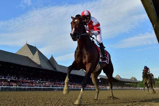 Songbird with jockey Mike Smith outruns the field to win the 100th running of The Coaching Club American Oaks Sunday July 24 2016 at the Saratoga Race Course in Saratoga Springs, N.Y. (Skip Dickstein/Times Union)