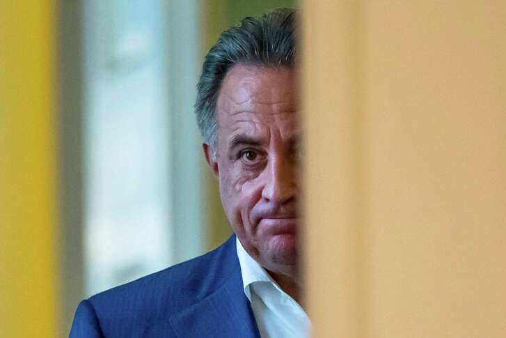 A stern-faced Vitaly Mutko, Russia's sports minister, prepares to meet the media after Sunday's decision.
