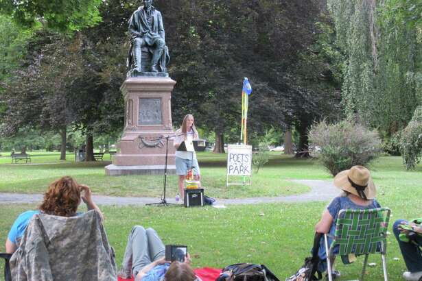 Mary Eliza Crane reading at Poets in the Park, July 16, 2016, under the statue of poet Robert Burns in Washington Park.  (Dan Wilcox)
