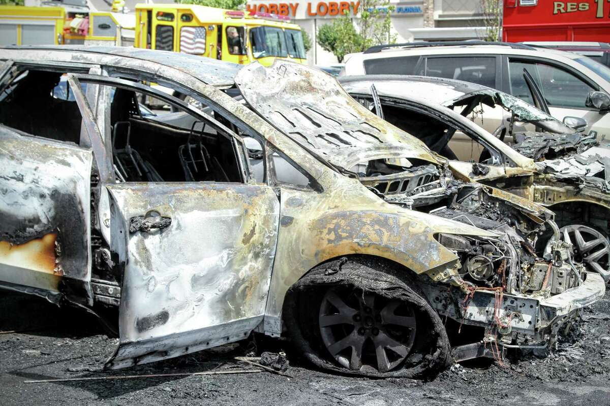 Four cars were damaged in the parking lot of the Latham Price Chopper Sunday afternoon after one of the cars inexplicably burst into flames. (Photo: J.p. Lawrence).
