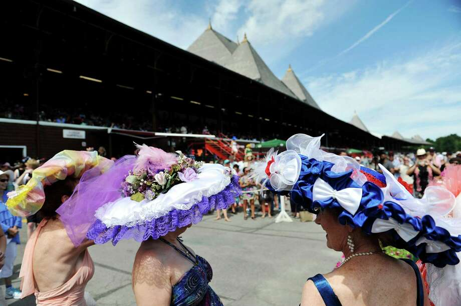 Women wearing their hats make their way to the stage during the 25th Annual Hats off to Saratoga hat contest presented by Hat Sational by DEI at the Saratoga Race Course on Sunday, July 24, 2016, in Saratoga Springs, N.Y.  Winners in the children's only category, Kreative Kids,  received a hat from Hat Sational and Saratoga Race Course merchandise.  Winners in the two other categories, Fashionably Saratoga, and Uniquely Saratoga, received gift certificates to Hat Sational for either $25, $50 or $100.  (Paul Buckowski / Times Union) Photo: PAUL BUCKOWSKI / 20037406A