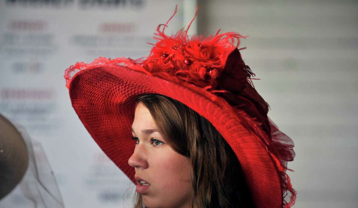 Kaitlyn Jacobs, 14, from Johnstown waits for the start of the 25th Annual Hats off to Saratoga hat contest presented by Hat Sational by DEI at the Saratoga Race Course on Sunday, July 24, 2016, in Saratoga Springs, N.Y. Winners in the children's only category, Kreative Kids, received a hat from Hat Sational and Saratoga Race Course merchandise. Winners in the two other categories, Fashionably Saratoga, and Uniquely Saratoga, received gift certificates to Hat Sational for either $25, $50 or $100. (Paul Buckowski / Times Union)